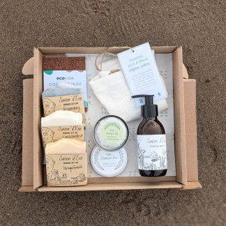 A box showing the contents of the gift set. 3 soaps, 1 liquid soap, shampoo bar and tin, soap rest and washcloth.