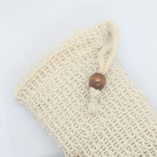Off white bag. Rough texture. Bead and pull tie thread for closure.