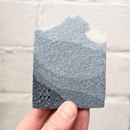 cuboid bar of soap. black , grey to white gradient in colour.